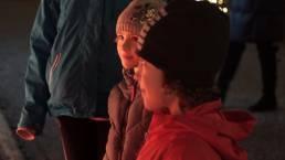 Still photo of children illuminated by light